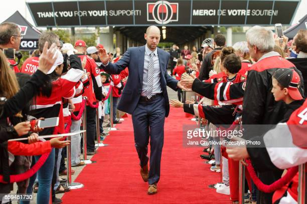 Craig Anderson of the Ottawa Senators walks the red carpet prior to the start of a game against the Detroit Red Wings at Canadian Tire Centre on...