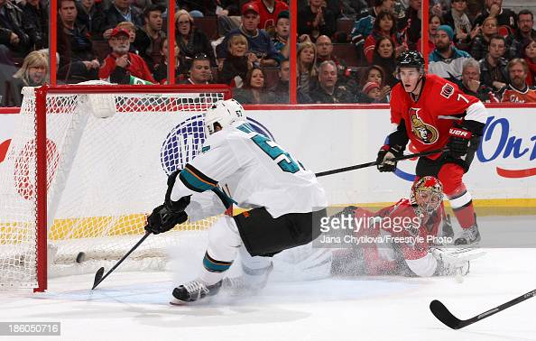 Craig Anderson of the Ottawa Senators watches as Tommy Wingels of the San Jose Sharks taps in a rebound to score a goal as Kyle Turris of the Ottawa...