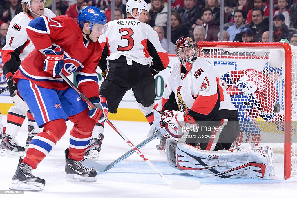 Craig Anderson #41 of the Ottawa Senators watches the rebounding puck in front of Alex Galchenyuk #27 of the Montreal Canadiens during the NHL game at the Bell Centre on February 3, 2013 in Montreal, Quebec, Canada.
