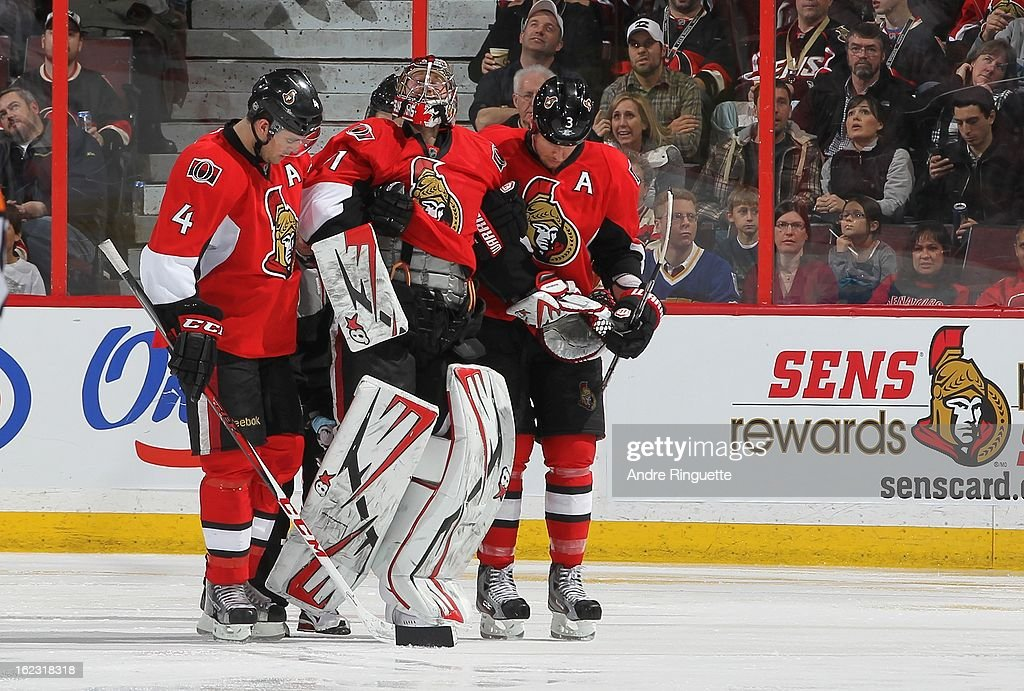 Craig Anderson #41of the Ottawa Senators is helped off the ice by teammates Chris Phillips #4, and Marc Methot #3 after being injured in the third period of an NHL game against the New York Rangers on February 21, 2013 at Scotiabank Place in Ottawa, Ontario, Canada.