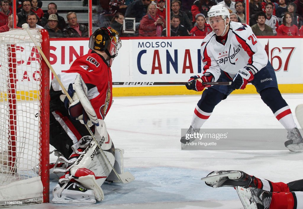 Craig Anderson the Ottawa Senators makes a save as Alexander Semin of the Washington Capitals swings his stick at the rebound at Scotiabank Place on...