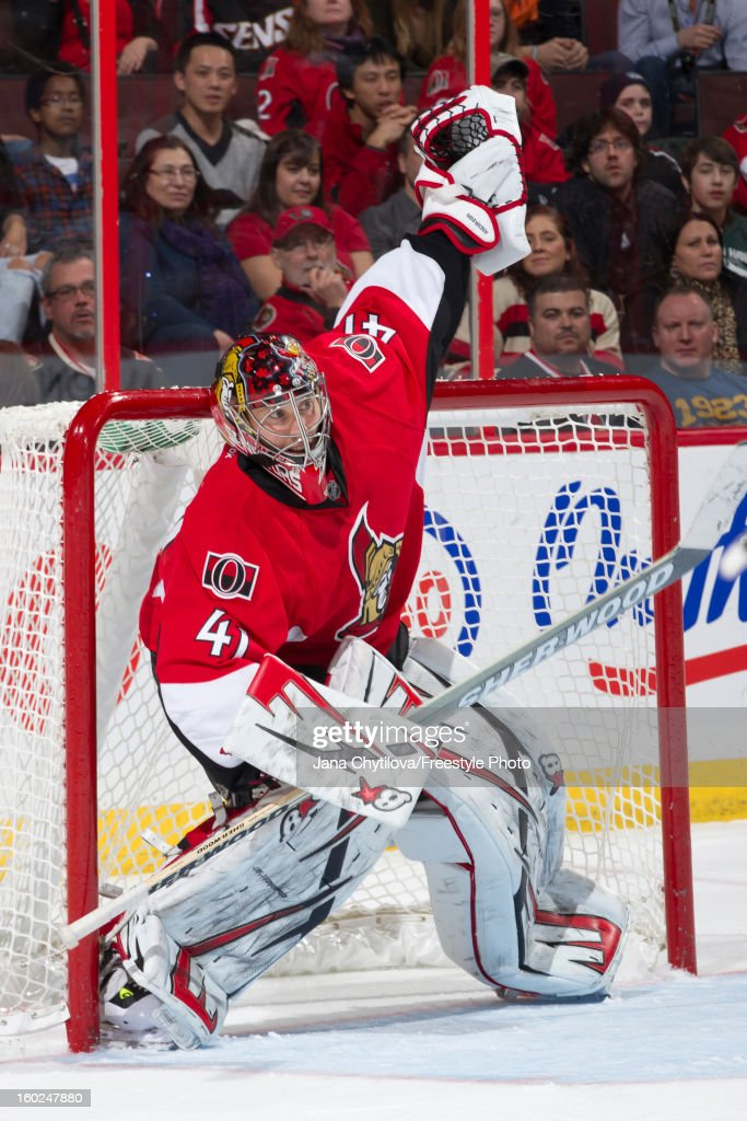 Craig Anderson #41of the Ottawa Senators raises his arm to indicate an icing call during an NHL game against the Pittsburgh Penguins at Scotiabank Place on January 27, 2013 in Ottawa, Ontario, Canada.