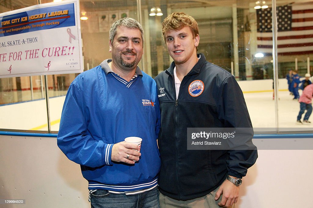 Craig Azoff and KC Krober pose for photos at the 2011 Breast Cancer Skate-a-Thon at the Abe Stark Arena on October 22, 2011 in New York City.