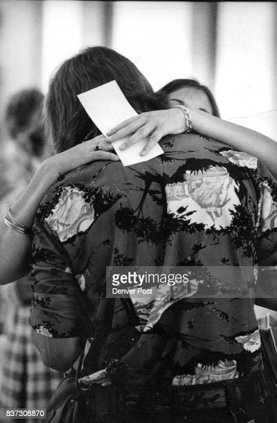 Craig Bates 18 gives a farewell embrace to Kris Walters 18 prior to Kris' departure Credit Denver Post