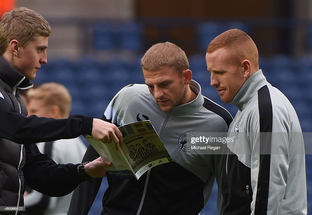 Craig Baxter and Matty Pattison of Gateshead are shown the matchday programme prior to the FA Cup Third Round match between West Bromwich Albion and...
