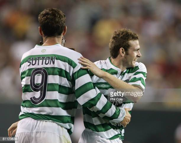 Craig Beattie celabrates with Chris Sutton of Celtic during the Champions World Series Game between Manchester United and Celtic July 28 2004 at...