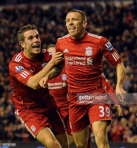 Craig Bellamy celebrates with Jordan Henderson after scoring Liverpool's second goal during the Carling cup semi final second leg between Liverpool...