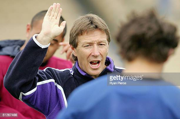 Craig Bellamy coach of the Storm addresses his players during Melbourne Storm training at Olympic Park on September 7 2004 in Melbourne Australia