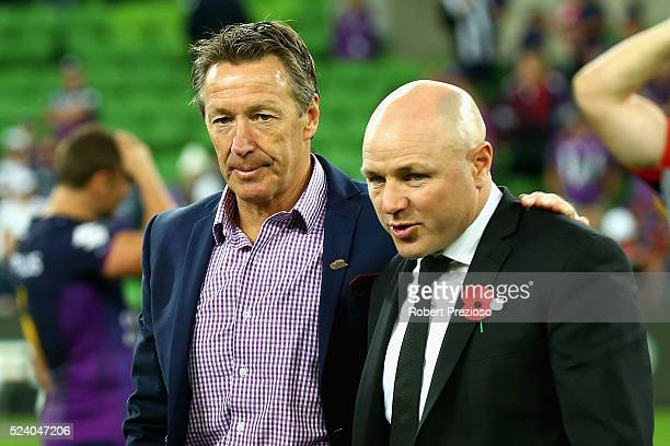 Craig Bellamy coach of the Storm and Andrew McFadden coach of the Warriors look on during the round eight NRL match between the Melbourne Storm and...