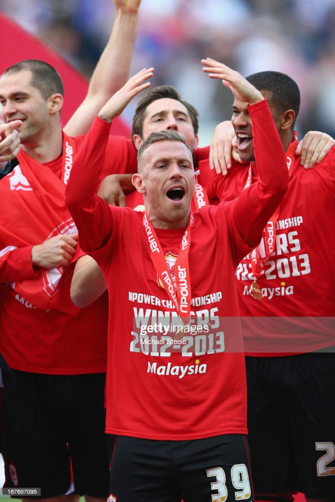 <a gi-track='captionPersonalityLinkClicked' href=/galleries/search?phrase=Craig+Bellamy+-+Soccer+Player&family=editorial&specificpeople=203318 ng-click='$event.stopPropagation()'>Craig Bellamy</a> of Cardiff City celebrates as the Championship trophy is presented during the npower Championship match between Cardiff City and Bolton Wanderers at the Cardiff City Stadium on April 27, 2013 in Cardiff, Wales.