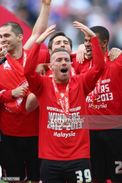 Craig Bellamy of Cardiff City celebrates as the Championship trophy is presented during the npower Championship match between Cardiff City and Bolton...