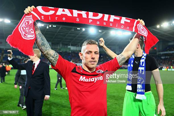 Craig Bellamy of Cardiff City celebrates his team's promotion to the Premier League at the end of the npower Championship match between Cardiff City...