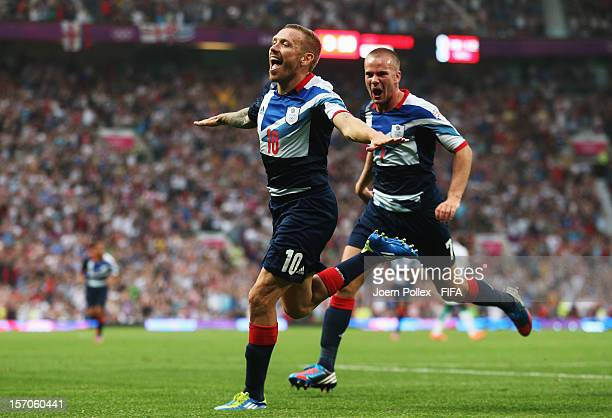 Craig Bellamy of Great Britain celebrates with his team mate Tom Cleverley after scoring his team's first goal during the Men's Football first round...