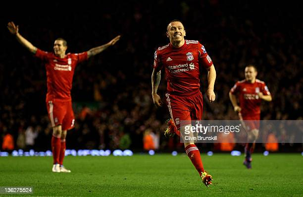 Craig Bellamy of Liverpool celebrates scoring his team's second goal during the Barclays Premier League match between Liverpool and Newcastle United...