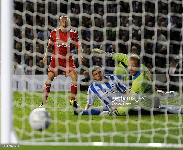 Craig Bellamy of Liverpool scores the opening goal during the Carling Cup third round match between Brighton Hove Albion and Liverpool at Amex...