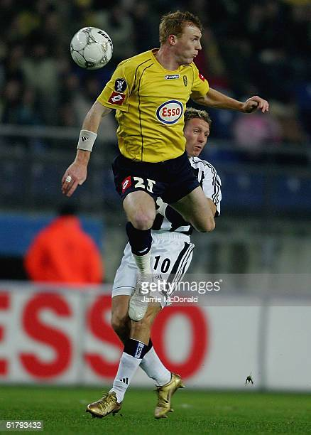 Craig Bellamy of Newcastle battles with Jeremy Mathieu of Sochaux during the UEFA Cup Group D match between FC Sochaux and Newcastle United at the...