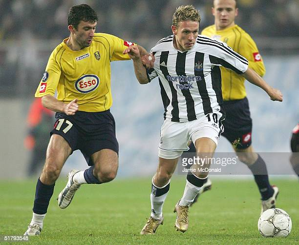 Craig Bellamy of Newcastle holds off Romain Pitau of Sochaux during the UEFA Cup Group D match between FC Sochaux and Newcastle United at the Stade...