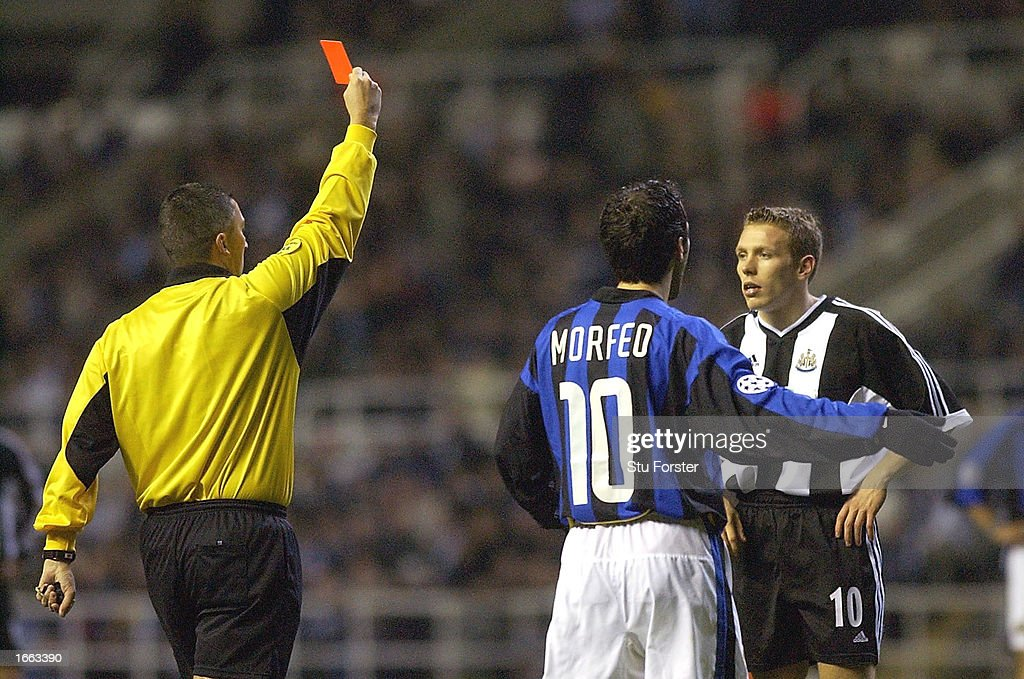 Craig Bellamy of Newcastle is shown the red card during the Champions League, second phase group A, match between Newcastle United and Internazionale Milan at St James' Park on November 27, 2002 in Newcastle, England. (Photo by Stu Forster/Getty Images).