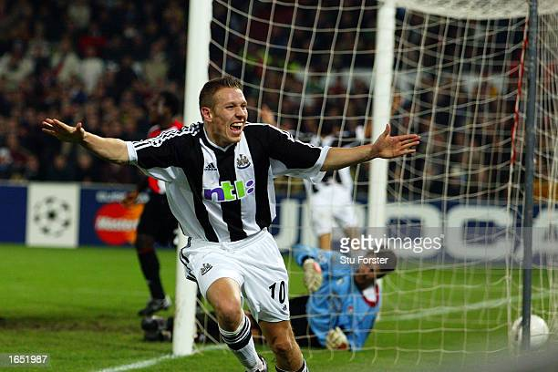 Craig Bellamy of Newcastle United celebrates after scoring the winning goal during the UEFA Champions League First Phase Group E match between...