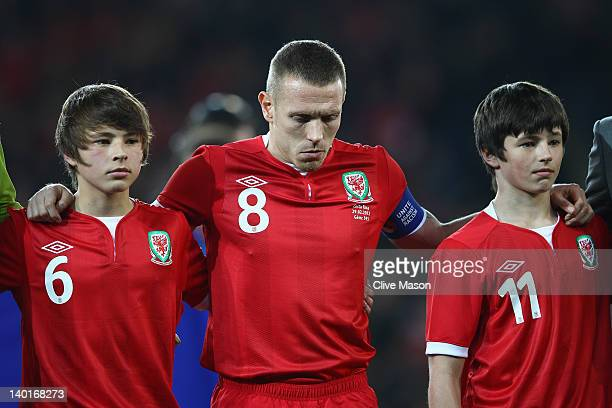 Craig Bellamy of Wales is seen with Edward and Thomas Speed during the national anthem during the Gary Speed Memorial International Match between...