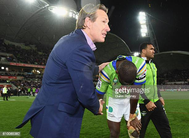 Craig Bellamy the coach of the Storm shakes hands with Edrick Lee of the Raiders after the Storm won the NRL Preliminary Final match between the...