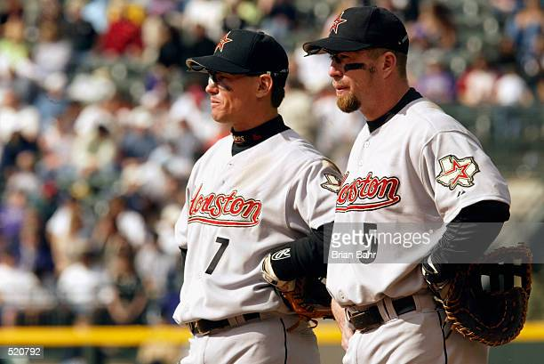 Craig Biggio and Jeff Bagwell of the Houston Astros watch the game against the Colorado Rockies at Coors Field in Denver Colorado on April 8 2002 The...