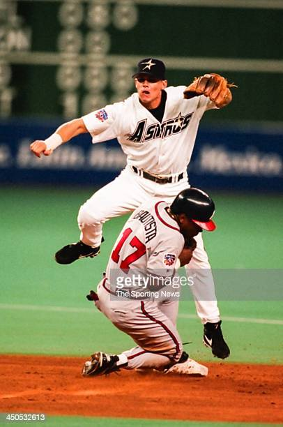 Craig Biggio of the Houston Astros attempts to turn a double play during the game against the Atlanta Braves at the Astrodome on August 19 1997 in...