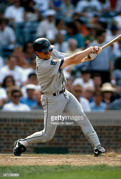 Craig Biggio of the Houston Astros bats against the Chicago Cubs during an Major League Baseball game circa 1994 at Wrigley Field in Chicago Illinois...