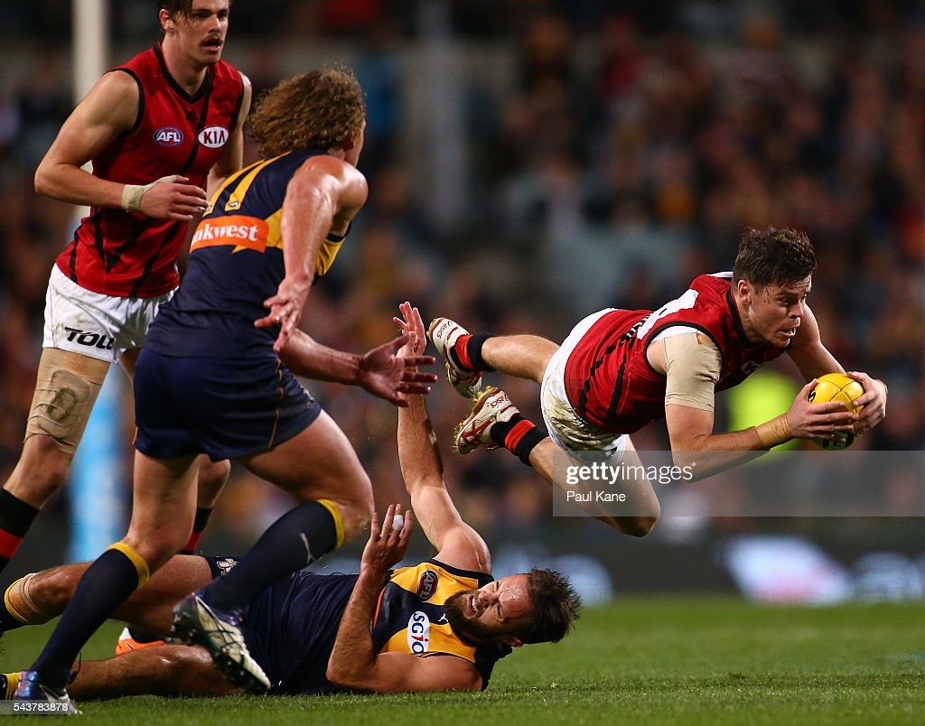 Craig Bird of the Bombers gathers the ball during the round 15 AFL match between the West Coast Eagles and the Essendon Bombers at Domain Stadium on June 30, 2016 in Perth, Australia.