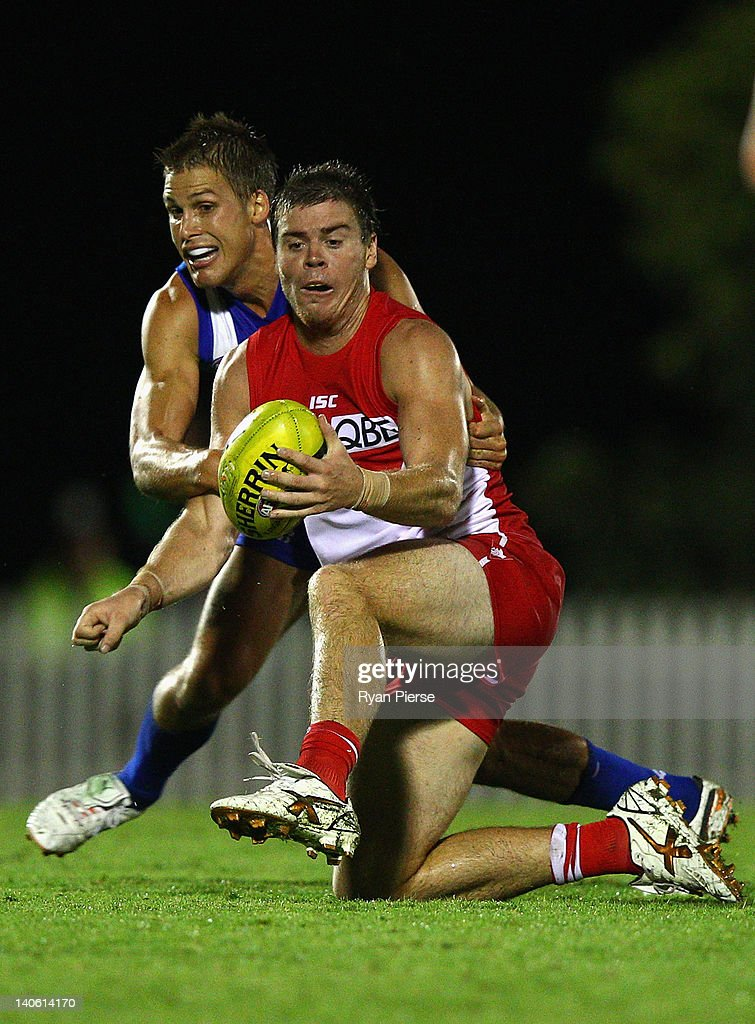 Craig Bird of the Swans is tackled by <a gi-track='captionPersonalityLinkClicked' href=/galleries/search?phrase=Andrew+Swallow&family=editorial&specificpeople=608525 ng-click='$event.stopPropagation()'>Andrew Swallow</a> of the Kangaroos during the round two NAB Cup AFL match between the Sydney Swans and the North Melbourne Kangaroos at Bruce Purser Oval on March 3, 2012 in Sydney, Australia.