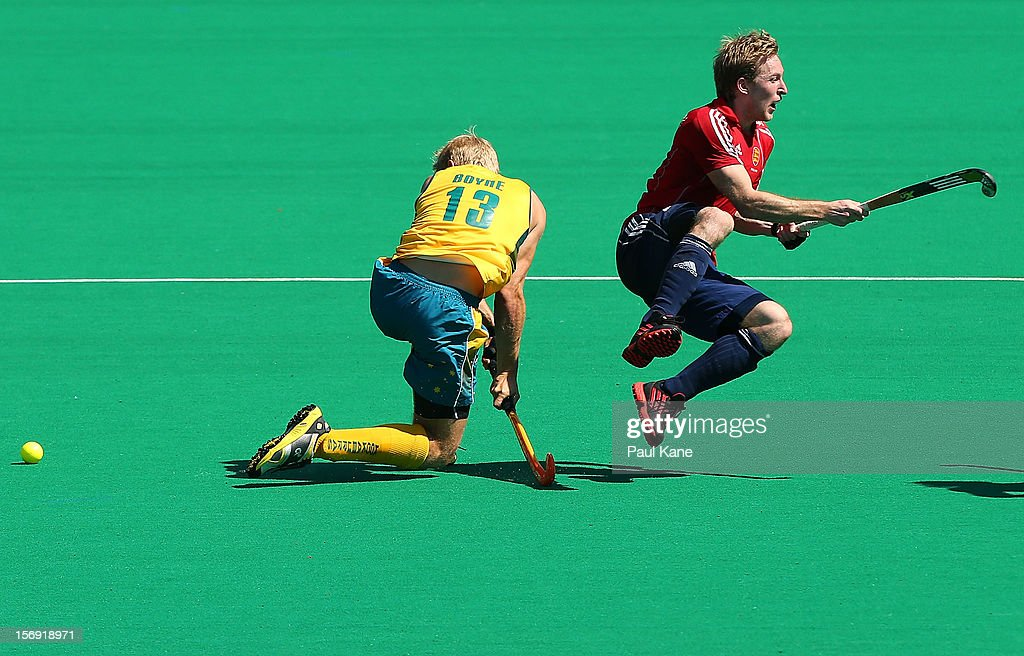 Craig Boyne of the Kookaburras tackles Barry Middleton of England in the gold medal match between the Australian Kookaburras and England during day four of the 2012 International Super Series at Perth Hockey Stadium on November 25, 2012 in Perth, Australia.