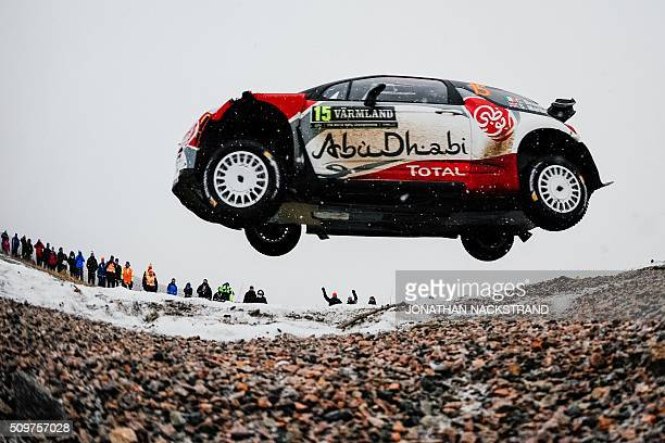 TOPSHOT Craig Breen of Ireland and his codriver Scott Martin of Britain steer their Citroen DS3 WRC during the 2nd stage of the Rally Sweden second...