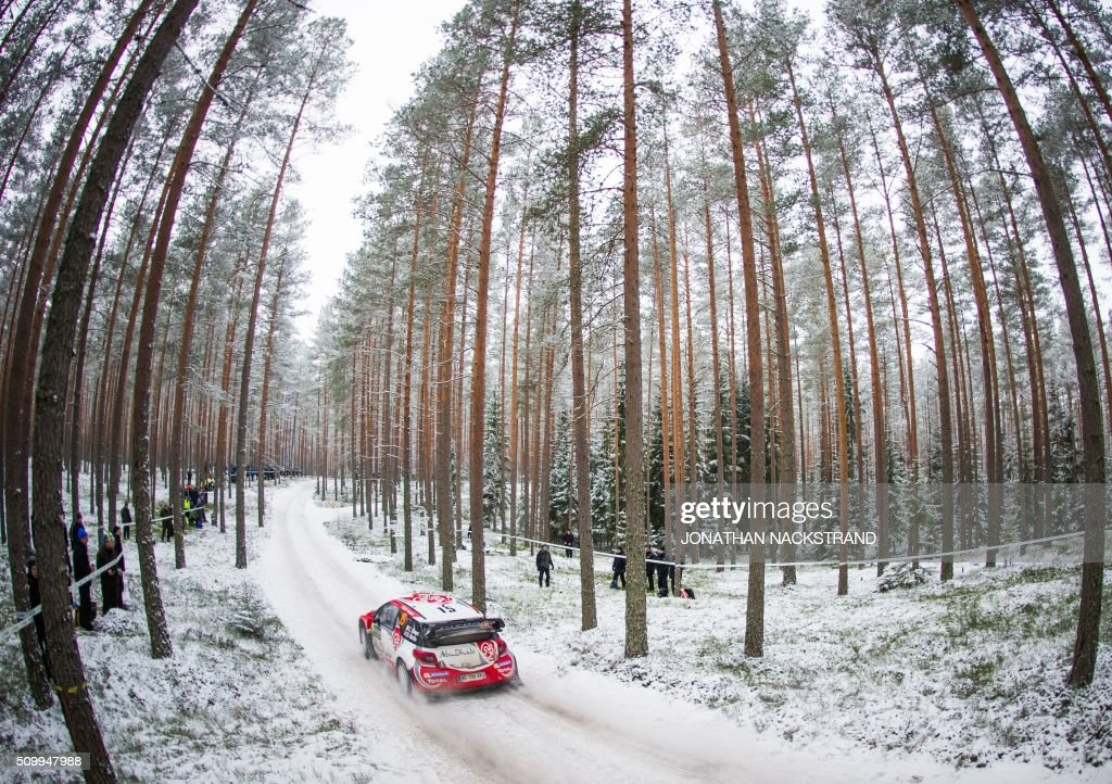 TOPSHOT Craig Breen of Ireland and his codriver Scott Martin of Britain steer their Citroen DS3 WRC during the 10th stage of the Rally Sweden second...