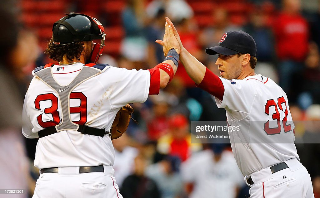Craig Breslow #32 of the Boston Red Sox celebrates with Jarrod Saltalamacchia #39 of the Boston Red Sox following their 5-1 win against the Tampa Bay Rays during the game on June 18, 2013 at Fenway Park in Boston, Massachusetts.