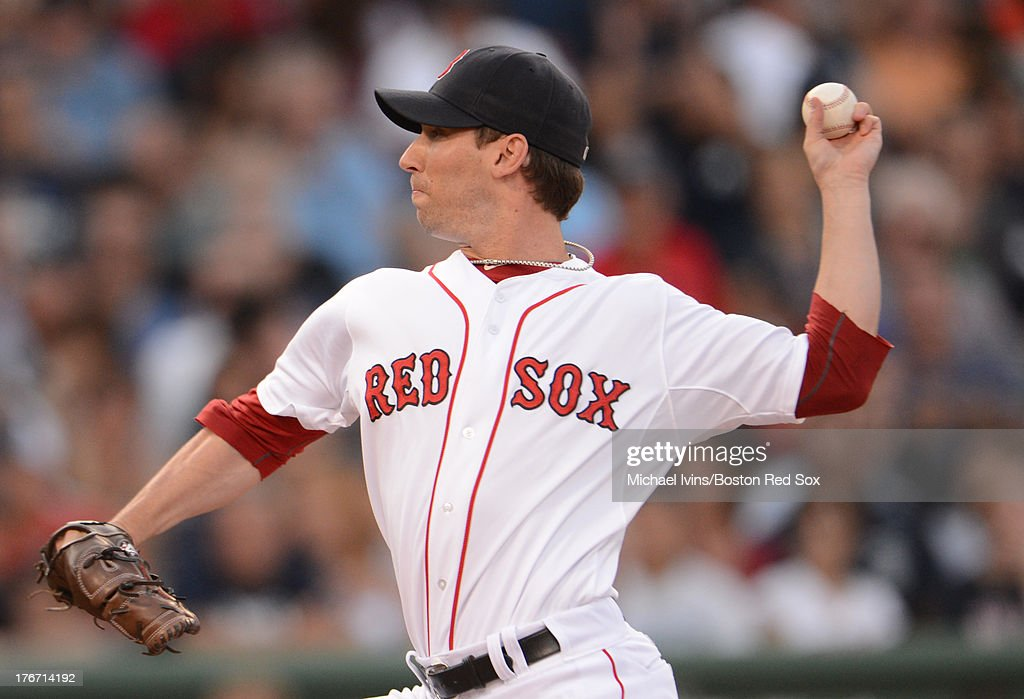 Craig Breslow #32 of the Boston Red Sox pitches against the New York Yankees during the seventh inning on August 17, 2013 at Fenway Park in Boston Massachusetts.