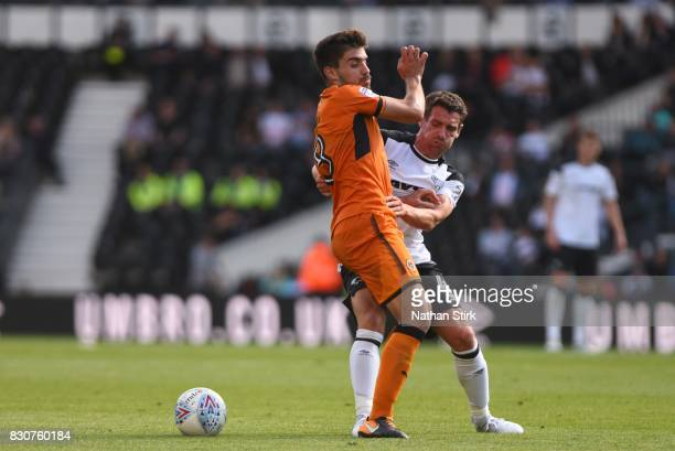 Craig Bryson of Derby and Rúben Neves of Wolves in action during the Sky Bet Championship match between Derby County and Wolverhampton at iPro...
