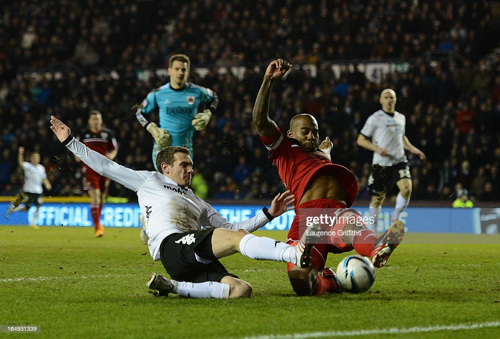 Craig Bryson of Derby County battles with <a gi-track='captionPersonalityLinkClicked' href=/galleries/search?phrase=Marvin+Elliott&family=editorial&specificpeople=234410 ng-click='$event.stopPropagation()'>Marvin Elliott</a> of Bristol City during the npower Championship match between Derby County and Bristol City at Pride Park Stadium on March 29, 2013 in Derby, England.
