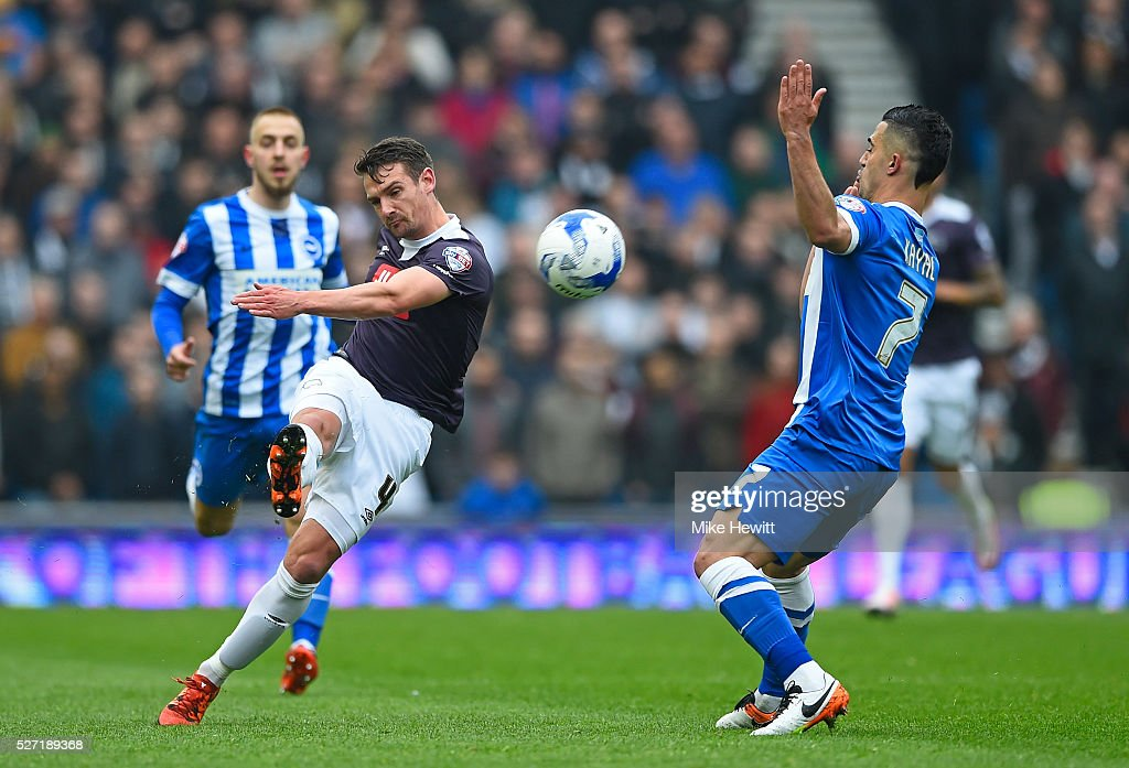Craig Bryson of Derby County cleas the ball under pressure from Biram Kayal of Brighton and Hove Albion during the Sky Bet Championship match between Brighton and Hove Albion and Derby County at the Amex Stadium on May 2, 2016 in Brighton, United Kingdom.