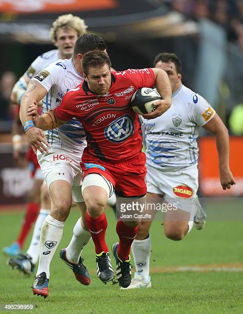 Craig Burden of RC Toulon runs with the ball during the Top 14 Final between RC Toulon and Castres Olympique at Stade de France on May 31 2014 in...