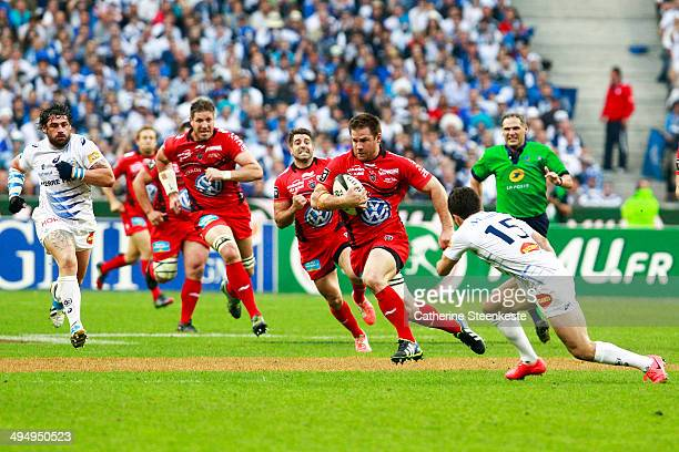 Craig Burden of the Rugby Club Toulonnais runs with the ball against Brice Dulin of Castres Olympique during the Top 14 Final game at Stade de France...
