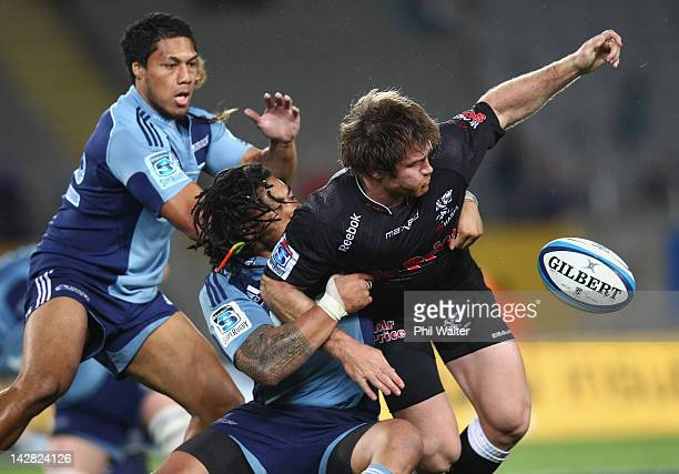Craig Burden of the Sharks looses the ball in a tackle from Ma'a Nonu of the Blues during the round eight Super Rugby match between the Blues and the...
