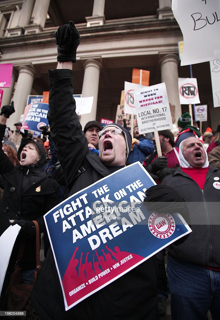 Craig Cable, of Newport, Michigan, a member of United Auto Workers Union Local 3000, and union members from around the country, rally at the Michigan State Capitol to protest a vote on Right-to-Work legislation December 11, 2012 in Lansing, Michigan. Republicans control the Michigan House of Representatives, and Michigan Gov. Rick Snyder has said he will sign the bill if it is passed. The new law would make requiring financial support of a union as a condition of employment illegal.
