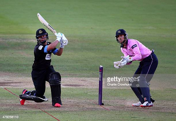 Craig Cachopa of Sussex hits out while John Simpson looks on during the NatWest T20 Blast match between Middlesex and Sussex at Lord's Cricket Ground...