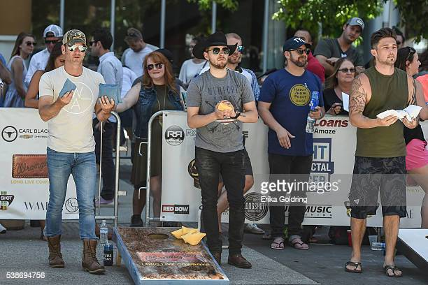 Craig Campbell Brett Kissell Kristian Bush and Michael Ray play cornhole during the 4th Annual Craig Campbell Cornhole Challenge on June 7 2016 in...