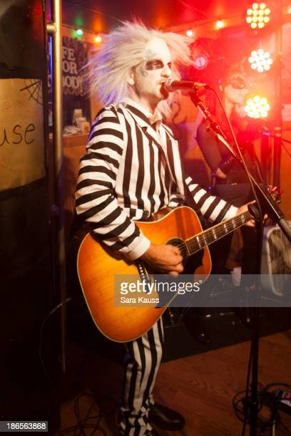 Craig Campbell performs at the TJ Martell Foundation's Battle for the Bones for the Linds Sarcoma Fund at Losers Bar Grill on October 31 2013 in...