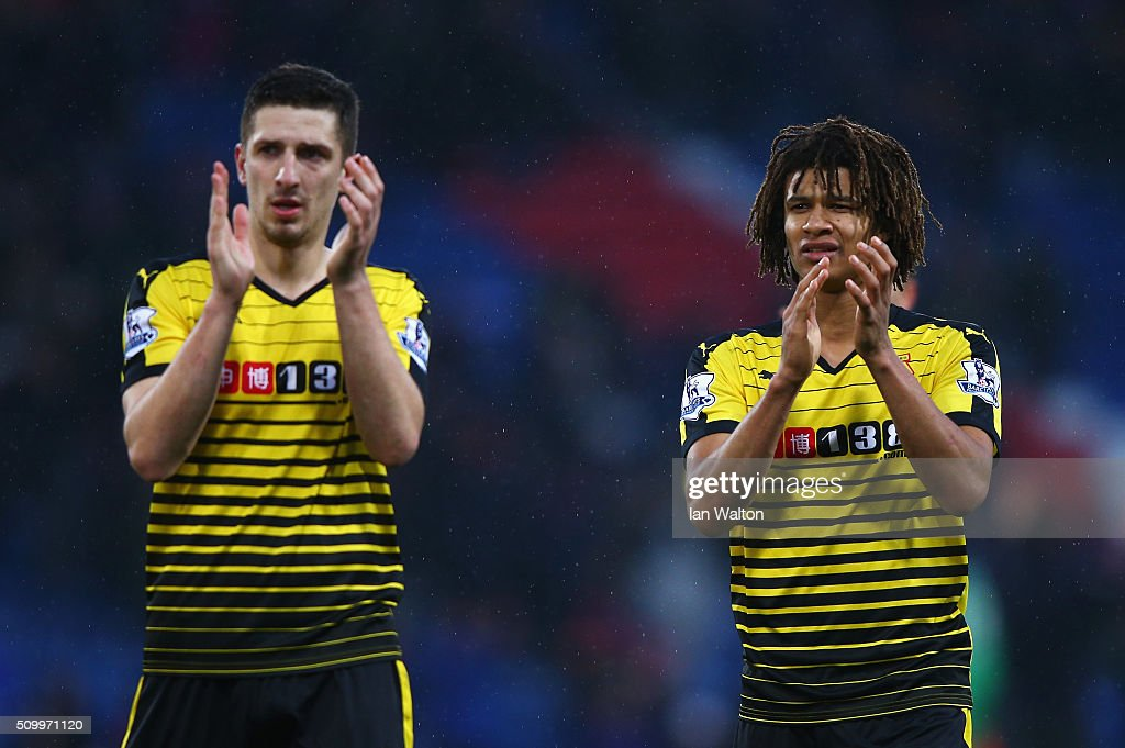 Craig Cathcart (L) and Nathan Ake (R) of Watford applaud away supporters after their 2-1 win in the Barclays Premier League match between Crystal Palace and Watford at Selhurst Park on February 13, 2016 in London, England.