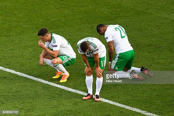 Craig Cathcart Conor Washington and Josh Magennis of Northern Ireland show their dejection after their team's 01 defeat in the UEFA EURO 2016 round...
