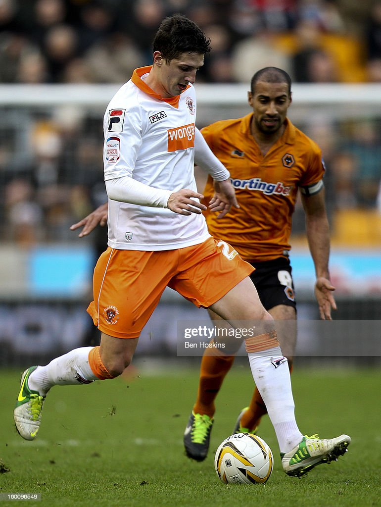 Craig Cathcart of Blackpool holds off pressure from <a gi-track='captionPersonalityLinkClicked' href=/galleries/search?phrase=Karl+Henry&family=editorial&specificpeople=2093810 ng-click='$event.stopPropagation()'>Karl Henry</a> of Wolves during the npower Championship match between Wolverhampton Wanderers and Blackpool at Molineux on January 26, 2013 in Wolverhampton, England.
