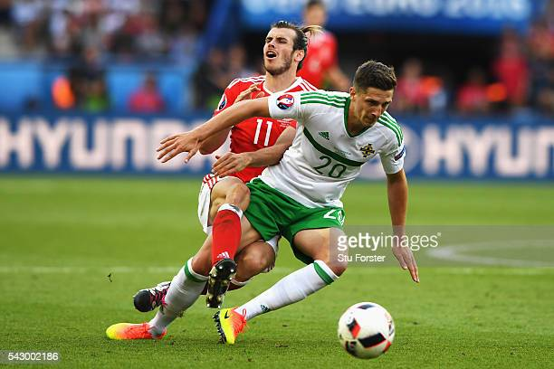 Craig Cathcart of Northern Ireland and Gareth Bale of Wales compete for the ball during the UEFA EURO 2016 round of 16 match between Wales and...