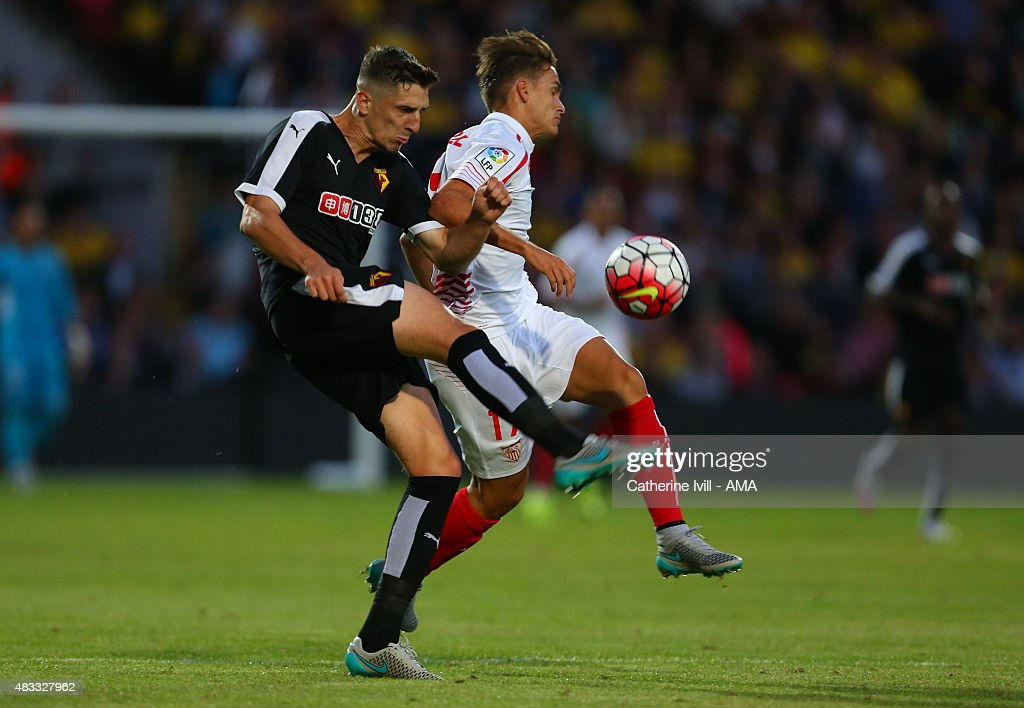 Craig Cathcart of Watford and Denis Suarez of Sevilla during the pre-season friendly between Watford and Seville at Vicarage Road on July 31, 2015 in Watford, England.